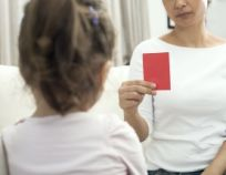 Mother is Showing Red Card to Child