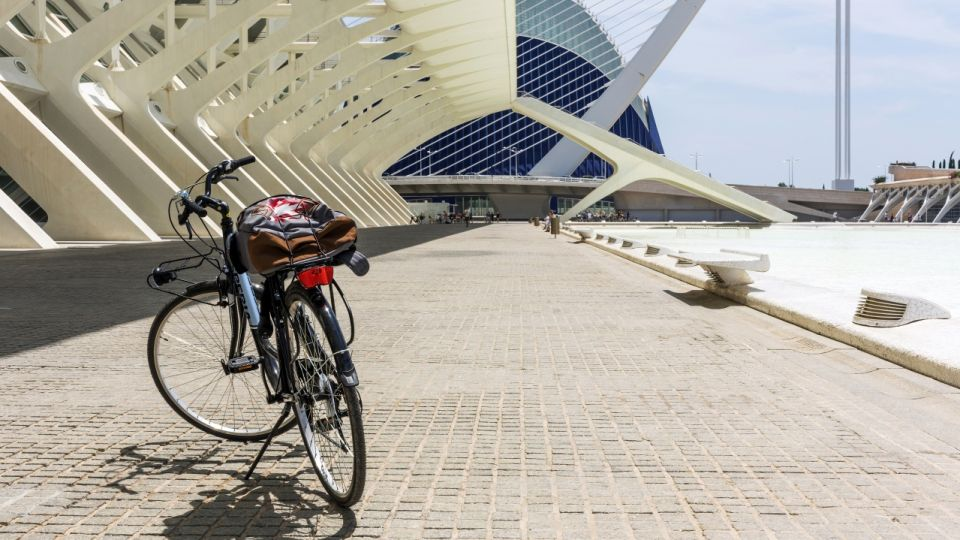 Bicycle parked on cobblestones in City of Arts and Sciences, Valencia, Spain