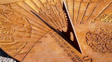 The old sundial shows almost noon on a Sunny day.