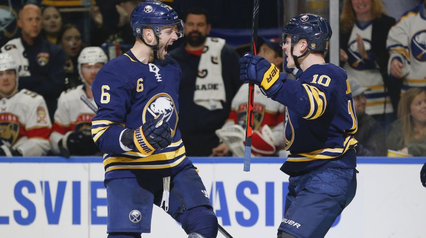 Marco Scandella (6) and Henri Jokiharju (Buffalo Sabres).