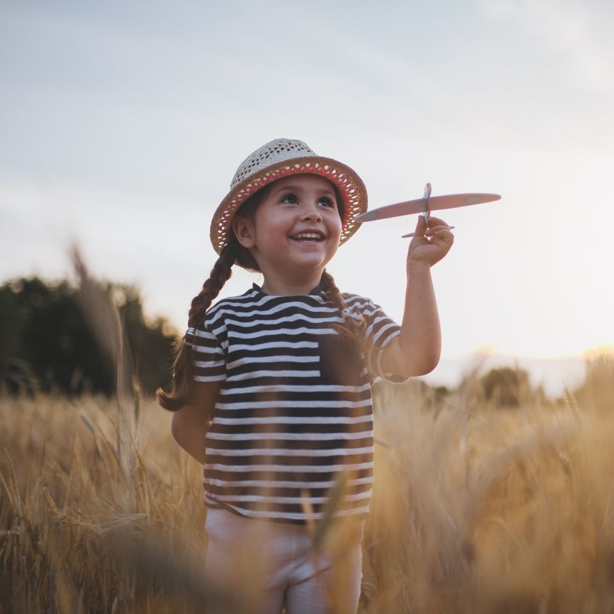 Happy child with a model airplane