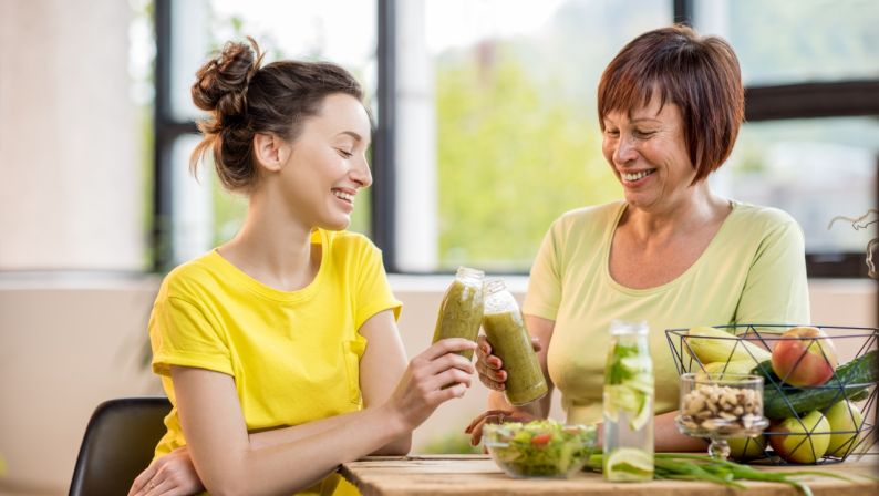 Young and older women with healthy food indoors