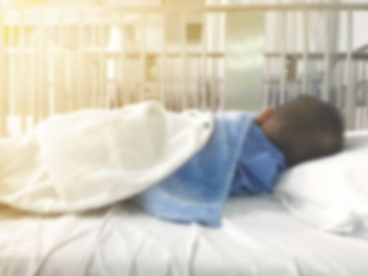 blurry illness asian kid with blue cloth sleeping on hospital bed. Health care and medical concept.
