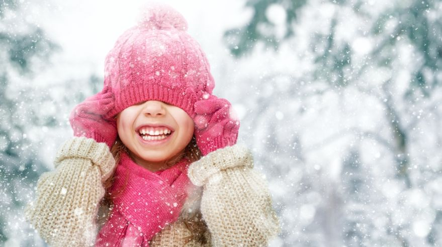 girl playing on a winter walk