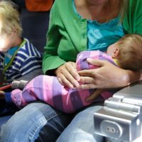 mother with newborn baby and little son travel by plane