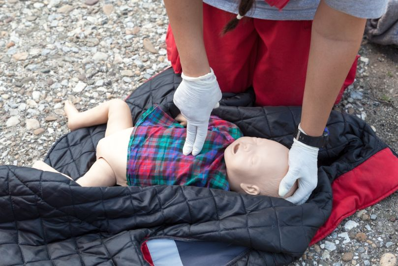 Infant dummy first aid. CPR.