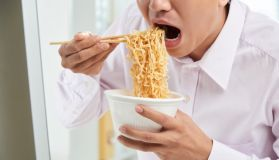 Young Man Eating Instant Noodles