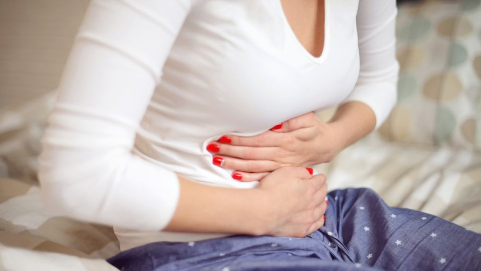 Young Women in the bedroom (abdominal pain)