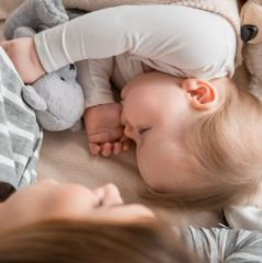 Pure infant resting with lovely mother