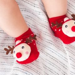Baby feet in funny Christmas socks.Happy holidays and Happy New Year