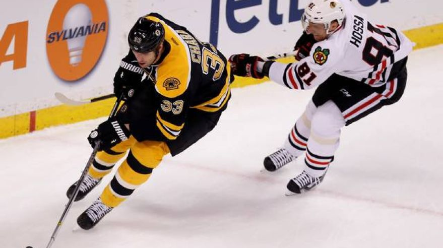 Boston chicago chara hossa mar14 reuters