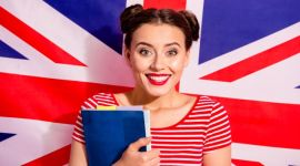 Close-up portrait of her she nice cute charming glamorous lovely winsome sweet attractive cheerful girl wearing striped t-shirt bachelor isolated over british flag background