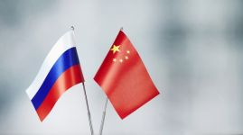 Chinese and Russian flag standing on the table