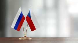 Russian And Czechoslovakian Flag Pair On A Desk Over Defocused Background