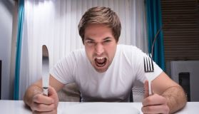 Angry Man Holding Knife And Fork