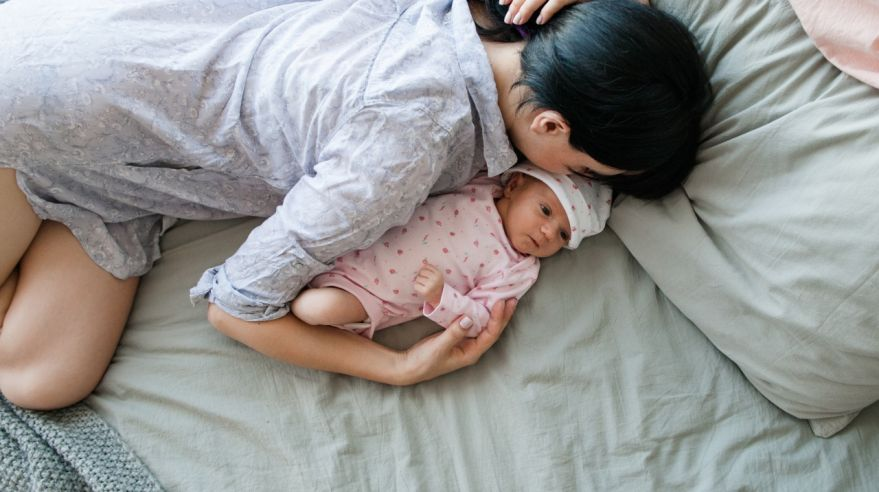 a mother's daytime sleep with her newborn baby
