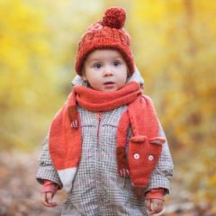 cute baby in autumn clothes. child in knitted hats and scarf