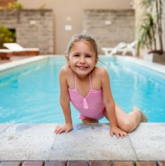 Happy Girl Swimming in Spa Pool