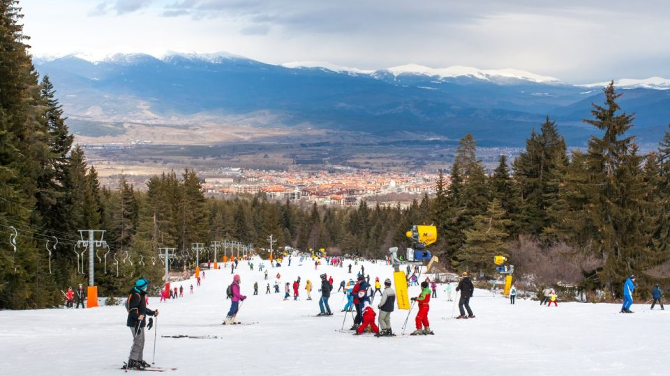 Skiers on the slope , ski lift, mountains view and Bansko