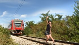 Woman taking dangerous selfie on railway track