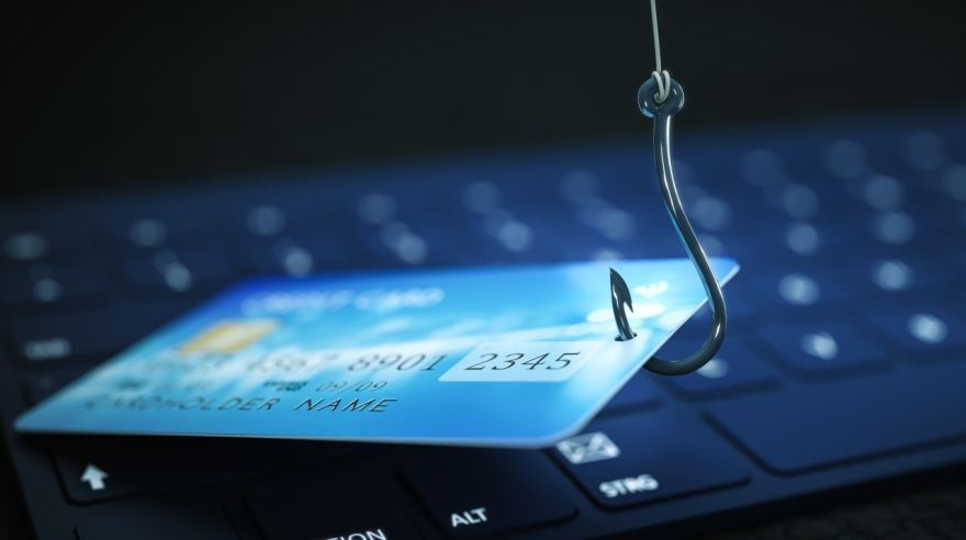 phishing credit card data with keyboard and hook symbol