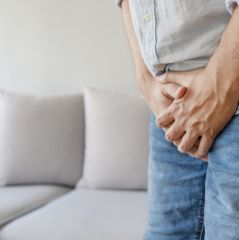 Male suffering with pain in the urogenital system