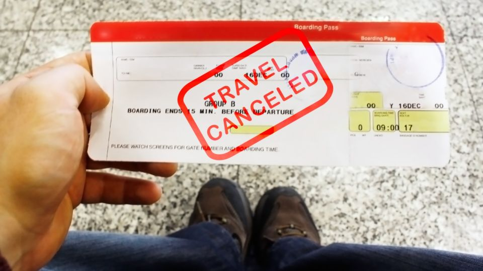 Travel canceled red stamp on boarding pass ticket