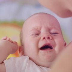 Breast-Feeding. Close up on crying baby