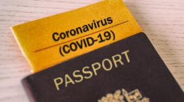Coronavirus COVID-19 Vaccination proof booklet in passport. Travel ban health certificate Corona screening of travelers tourists. Closure of airports restricted traveling