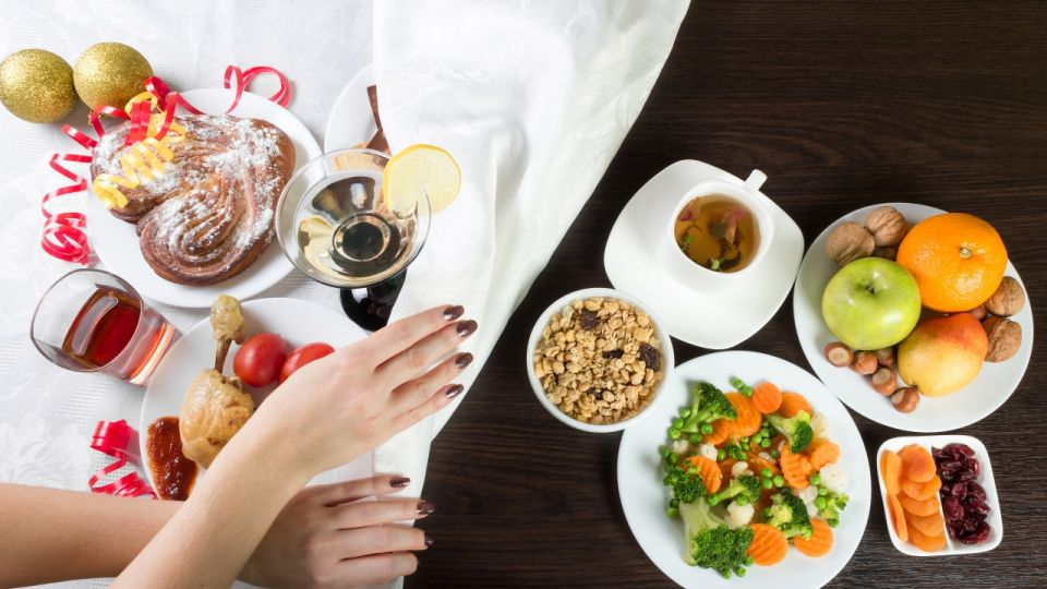 Table with healthy and unhealthy food and alcohol.
