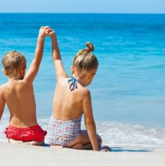 Happy kids have fun in summer camp on beach vacations