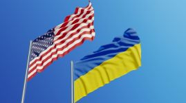 American and Ukrainian Flags Waving With Wind