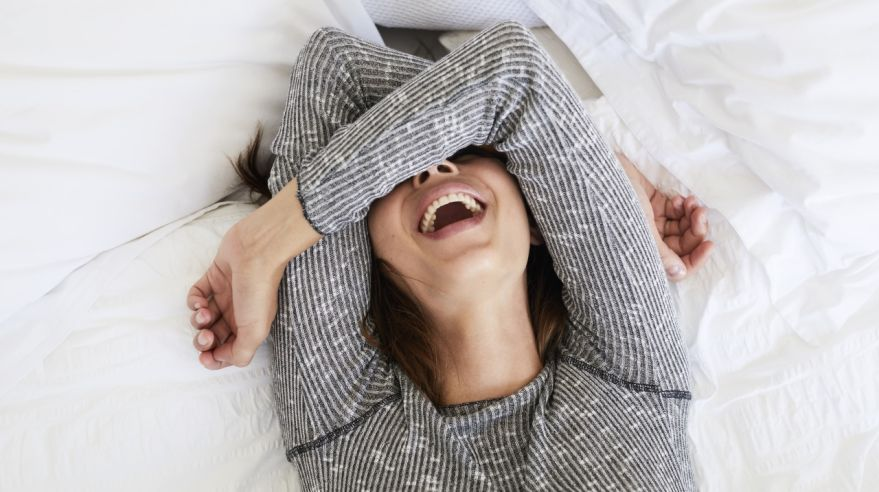 Laughing babe in bed