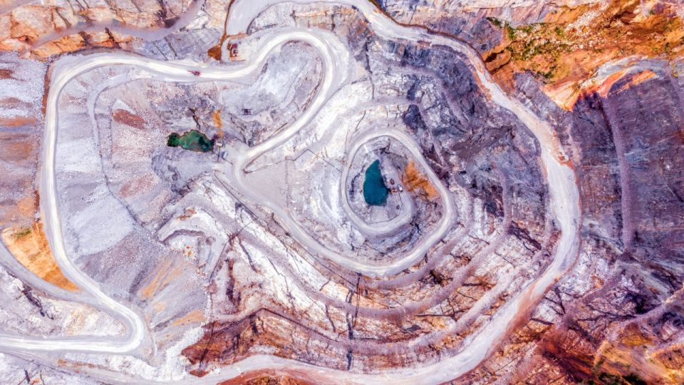 Top view of an open pit for the extraction of gold ore with depth of 250 meters