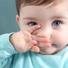 Close up of baby looking at camera with blue eyes