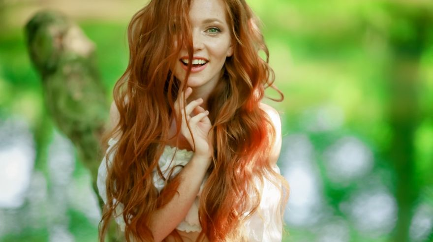 portrait of a girl with long red hair