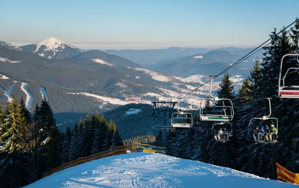 Stunning winter landscape at ski resort Bukovel in the Carpathians mountains copyspace people riding ski-lift to the top of the mountain lifestyle tourism seasonal recreation sports extreme concept