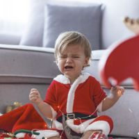 Crying santa baby boy