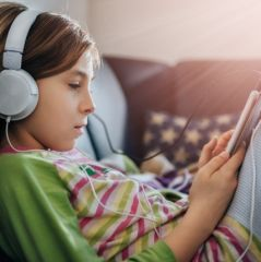 Girl using tablet and listening music