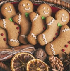 Christmas gingerbread man cookies on a wooden table.