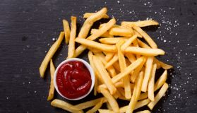 French fries with ketchup, top view