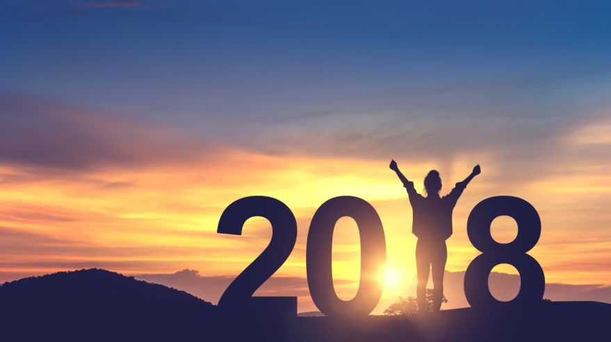 Woman enjoying on the hill and 2018 years while celebrating new year