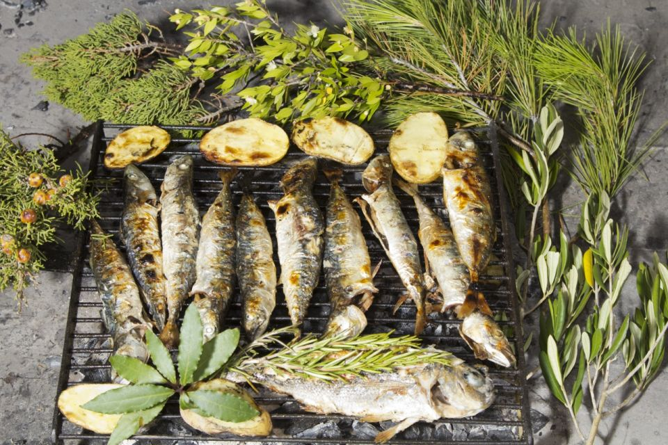 Fresh Mediterranean fishes with herbs on BBQ