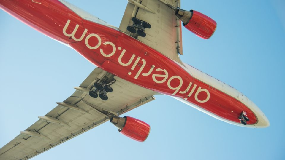 flying aeroplane Air Berlin from below