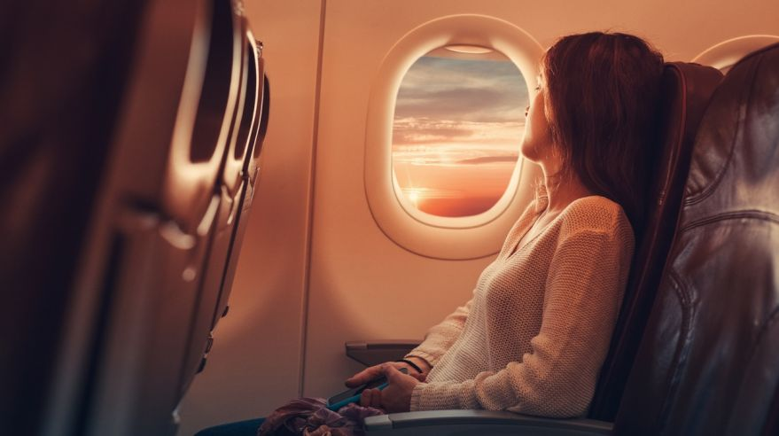Young woman flying to France
