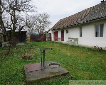 Starší dom s veľkým pozemkom v obci Peder