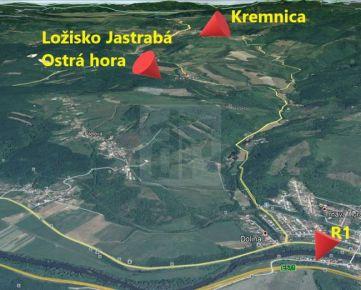Direct Real - Ostrá Hora - Ložisko andezitu Jastrabá, poľovný revír, zmiešaný les. Pozemok vhodný pre ťažbu aj rekreačné účely.