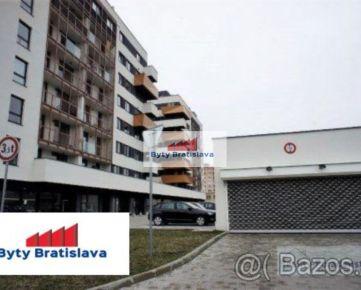 RK Byty Bratislava. Prenajmem garážové státie v novostavbe na Muchovom nám. BA V - Petržalka.