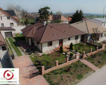 TRNAVA REALITY - luxusná 4 izb. novostavba s garážou a bazénom na tichej ulici v obci Dolné Lovčice