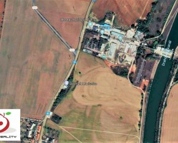 TRNAVA REALITY - stavebný pozemok s IS na hlavnom ťahu PN - TT - HC - D1 na okraji obce Madunice